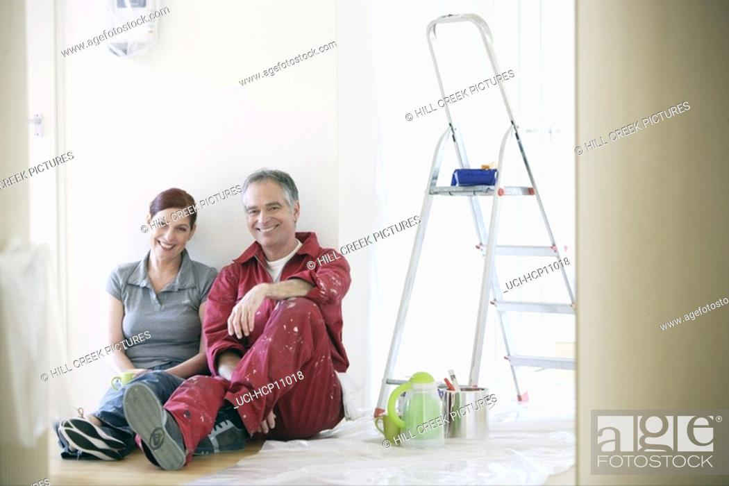 Stock Photo: Couple resting during painting.
