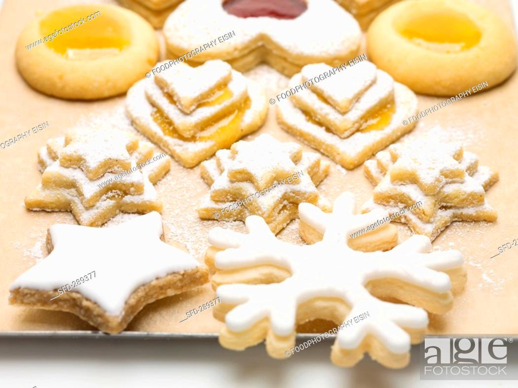 Assorted Jam Biscuits And Cinnamon Star On Baking Tray Stock Photo