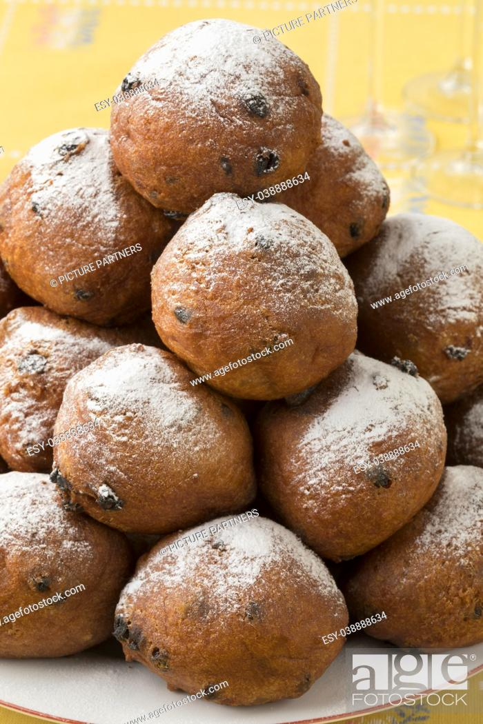 Photo de stock: Heap of oliebollen on a dish, close up, traditional Dutch pastry for New Year's Eve.