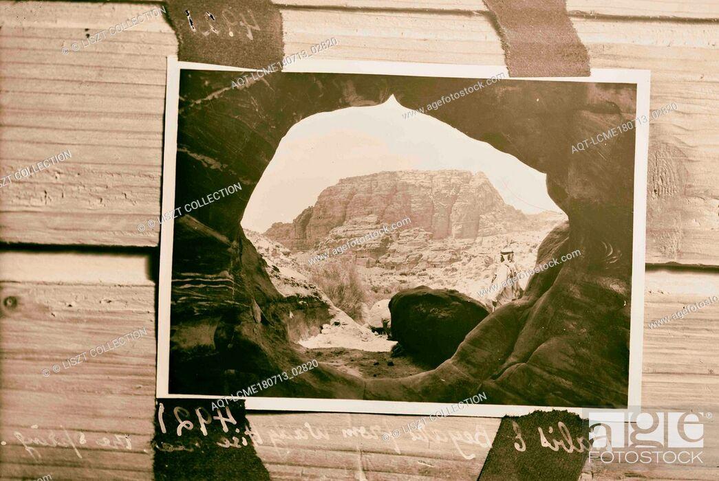 Stock Photo: Petra, Wadi Musa, El-M'esrah area. Umm el Biyara and el Habis. Taken through the opening of a cave. 1920, Jordan, Petra (Extinct city).