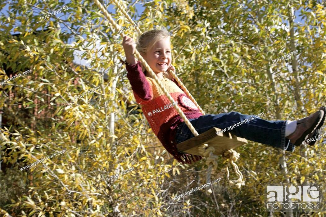 Stock Photo: Girl swinging.