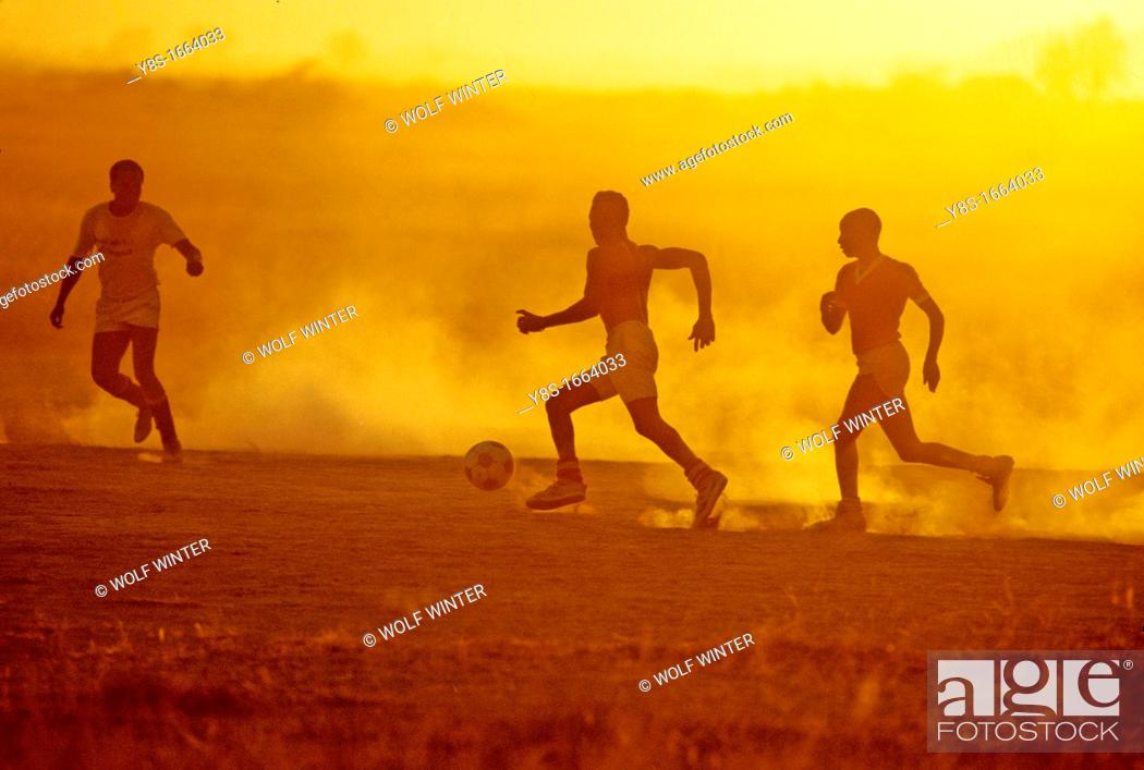 Stock Photo: Hotel Staff Members playing Soccer at Amboseli National Park.