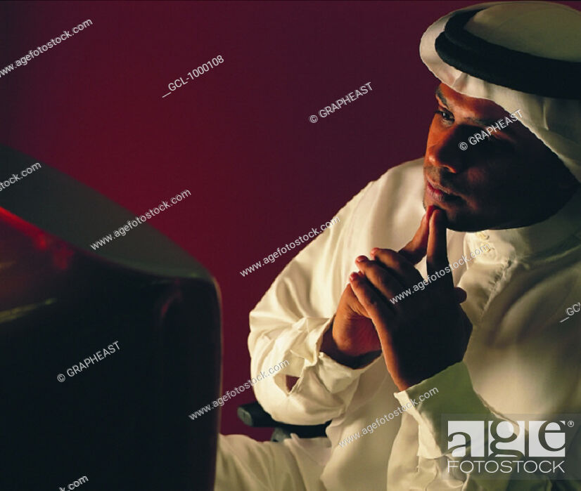 Stock Photo: Arab businessman working on computer.