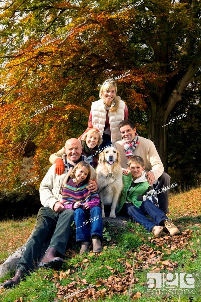 Stock Photo: Portrait of multi-generation family and dog in woods.