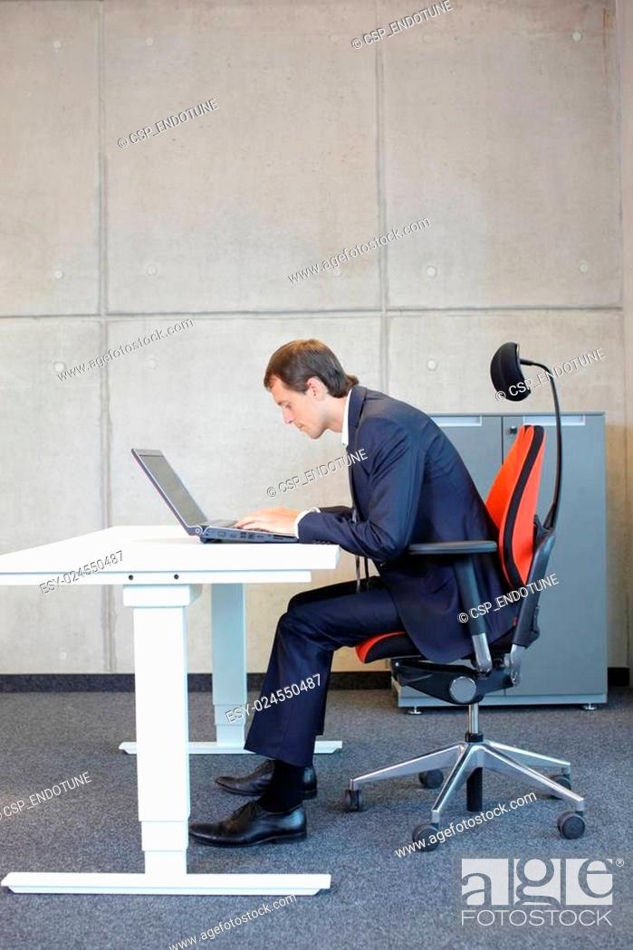 Stock Photo: Bad sitting posture at laptop.