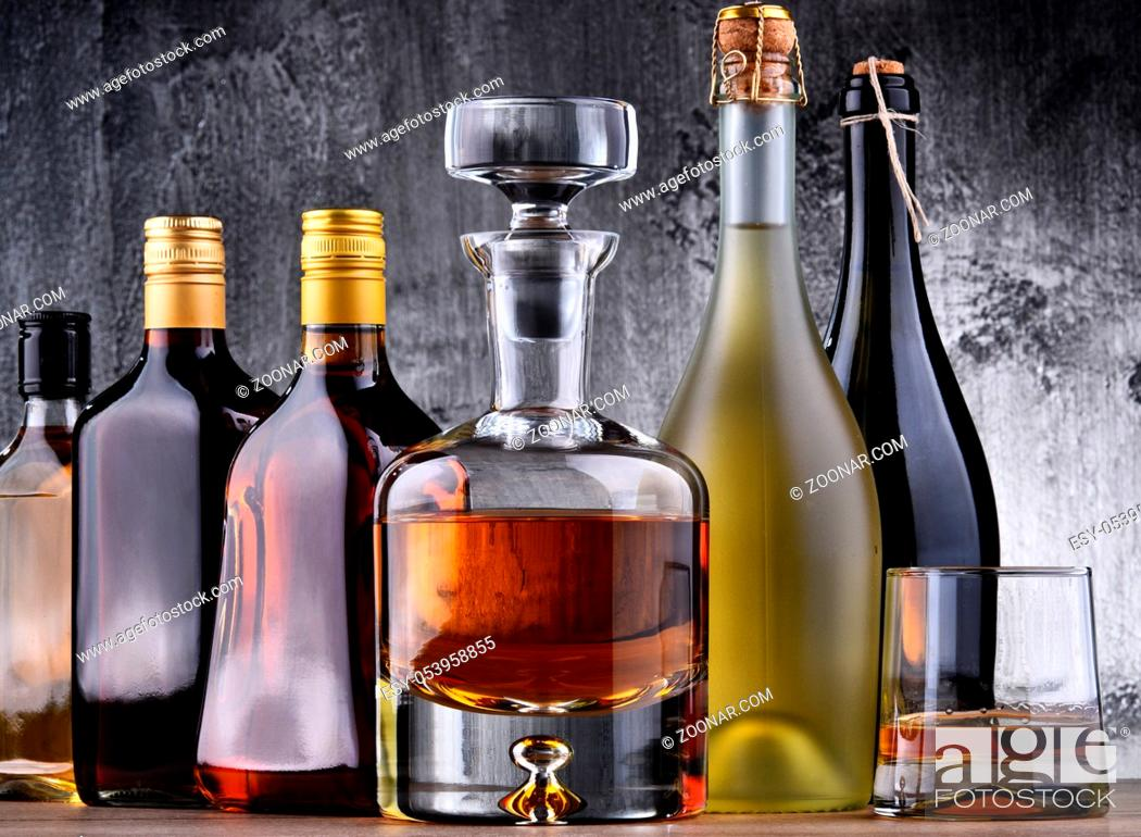Stock Photo: Composition with carafe and bottles of assorted alcoholic beverages.