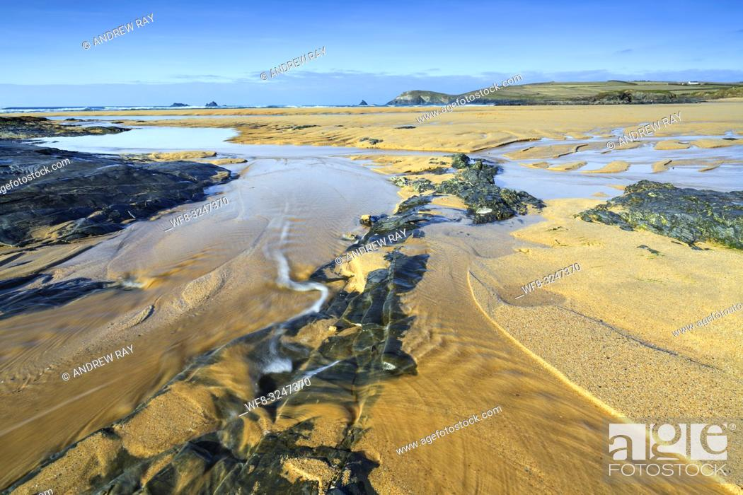 Stock Photo: A stream on Constantine Bay Beach on the north coast of Cornwall, with Trevose Head and Quies Rocks in the distance.