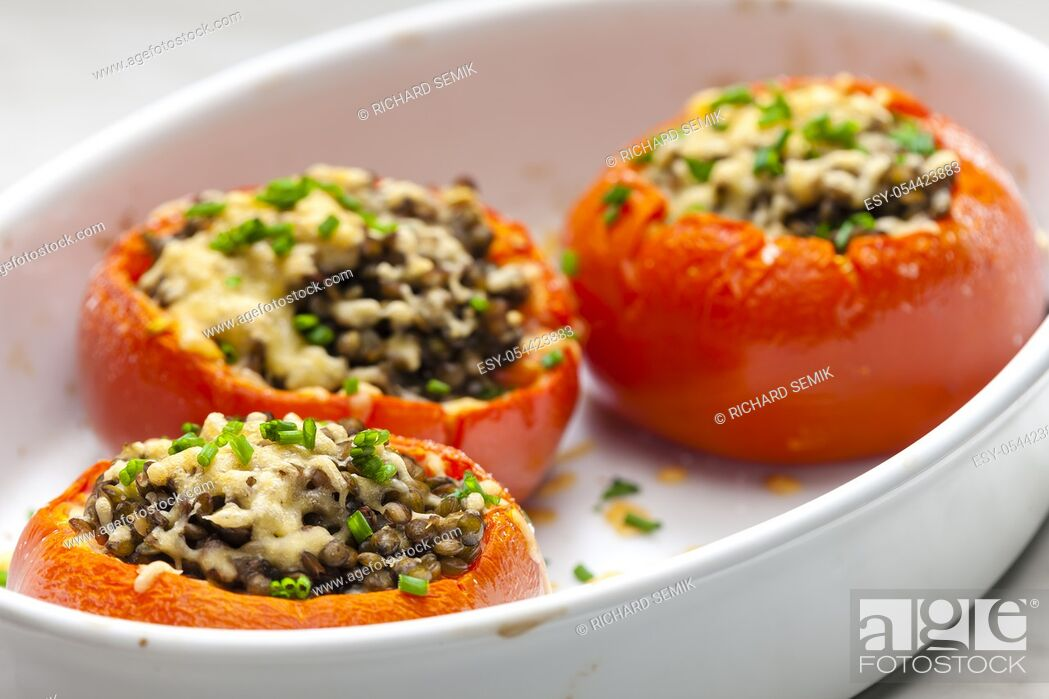 Stock Photo: baked tomatoes filled with lentils.