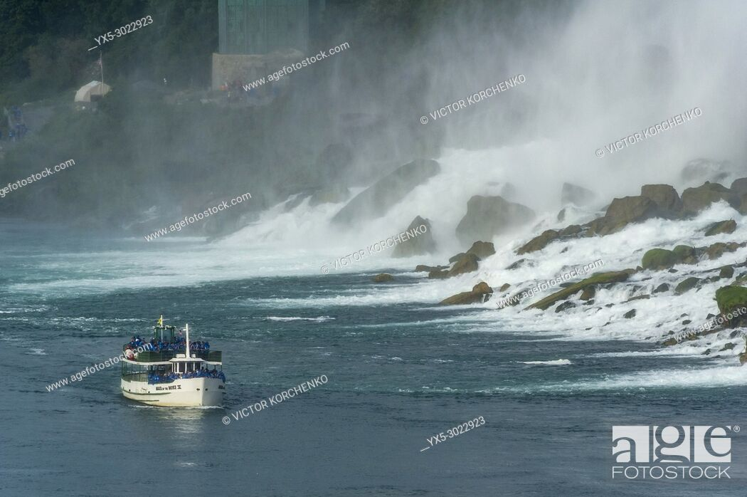 Stock Photo: Maid of the Mist boat carrying tourists at the foot of American Falls at Niagara Falls.