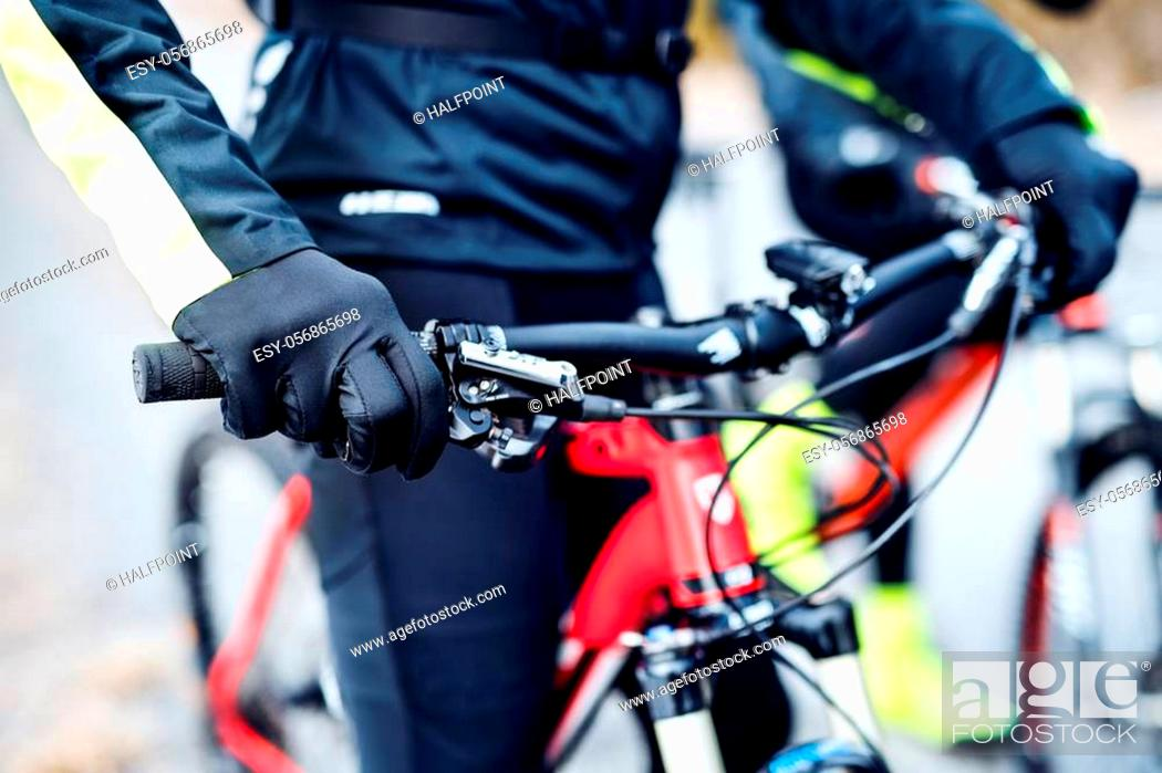 Stock Photo: A midsection of mountain biker on road outdoors in winter, hands on handlebars.