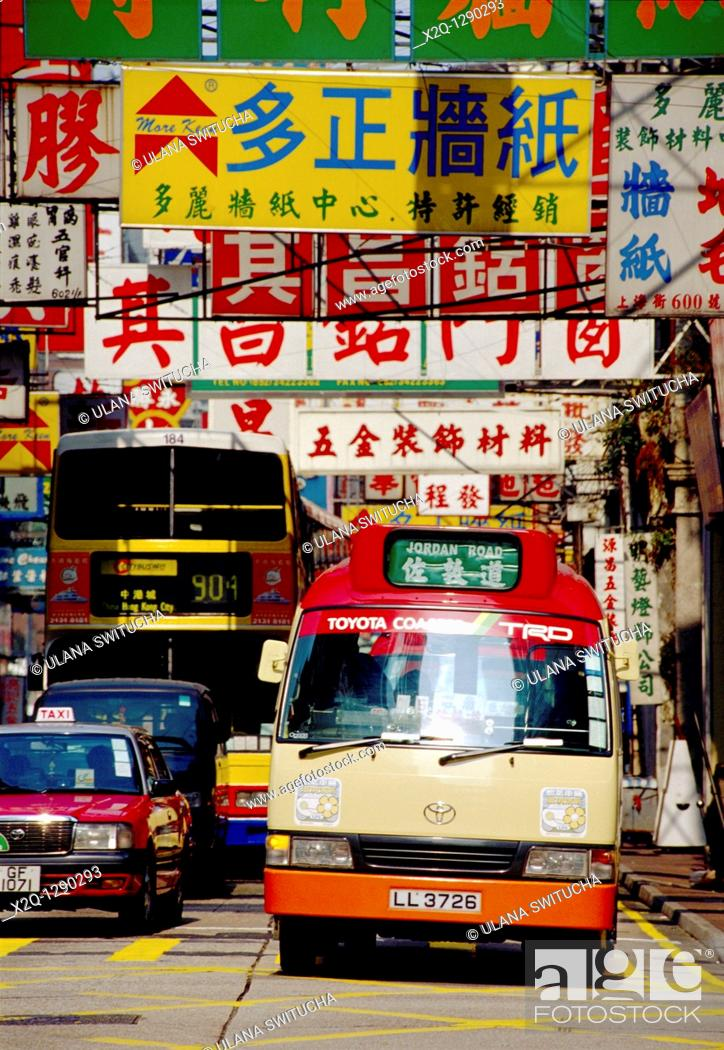 Stock Photo: Bus and taxi waiting at an intersection in Kowloon Hong Kong.