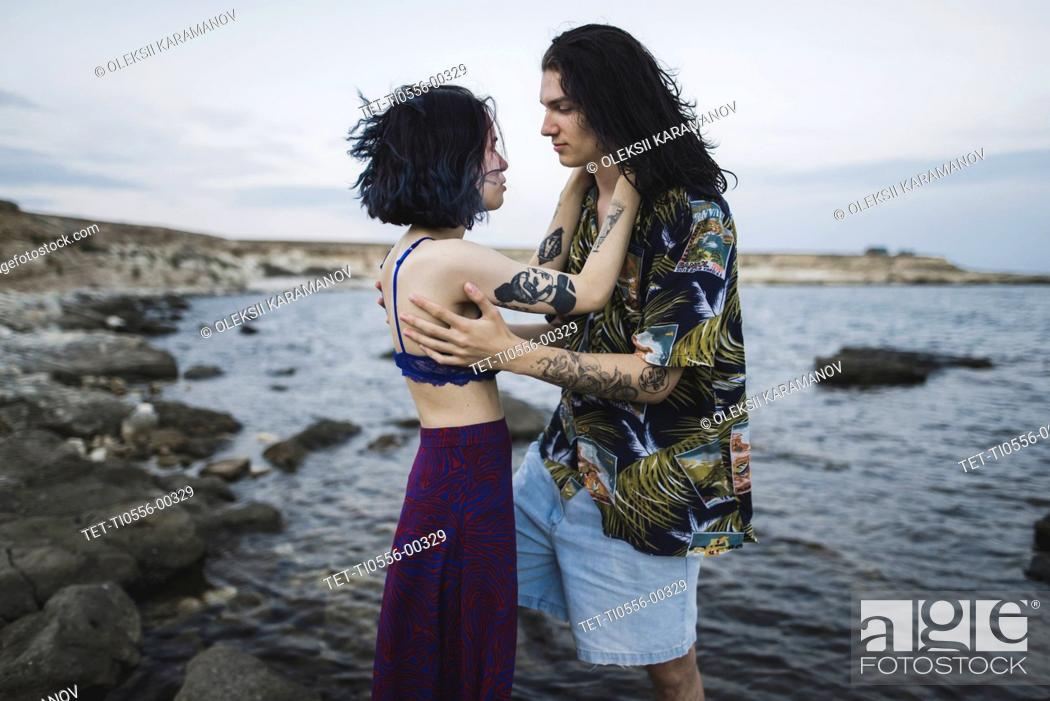 Stock Photo: Young couple face to face on beach.