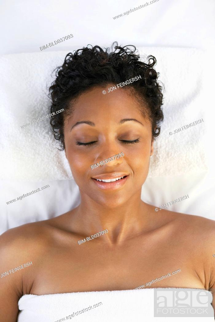 Stock Photo: African woman laying on spa table.