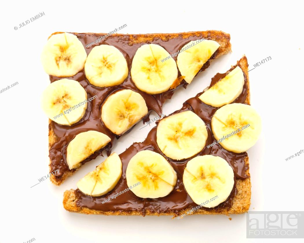 Photo de stock: overhead shot of chocolate toast with cut banana, isolated on white.