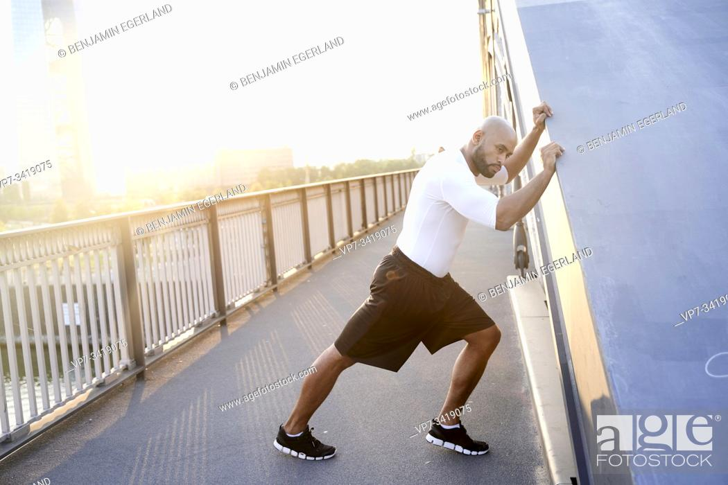 Stock Photo: athletic man training next to European Central Bank Tower EZB in Frankfurt, Germany.