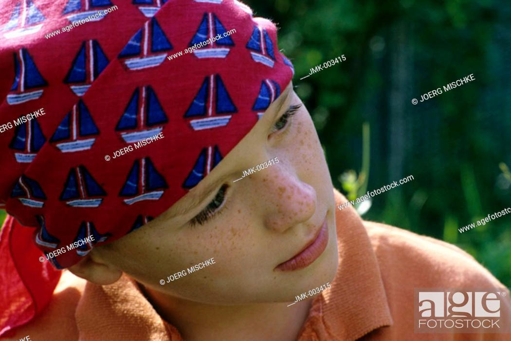 Stock Photo: Portrait of a boy, 5-10 years old, outside in summer.