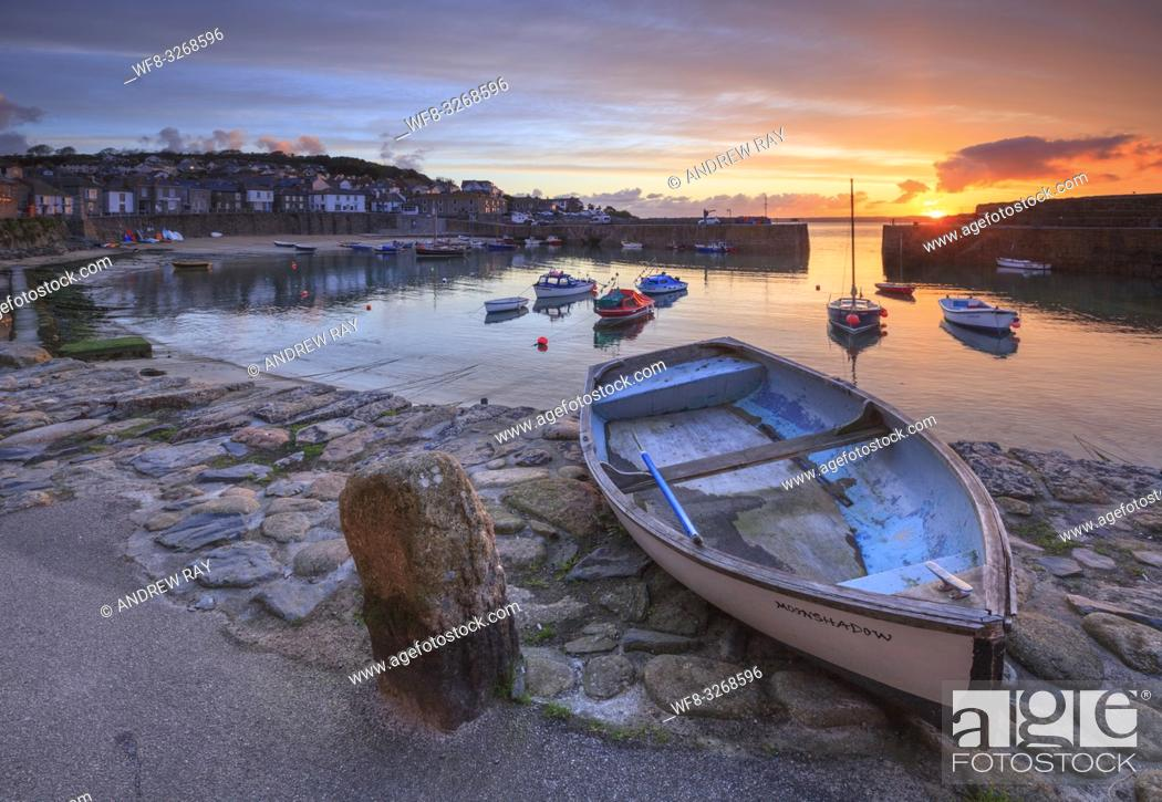 Stock Photo: Boats at picturesque Mousehole harbour, in the west of Cornwall. Captured from the harbour side, at sunrise in late April.