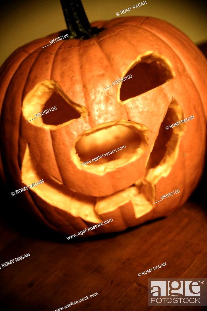 Stock Photo: Carved Halloween pumpkin.