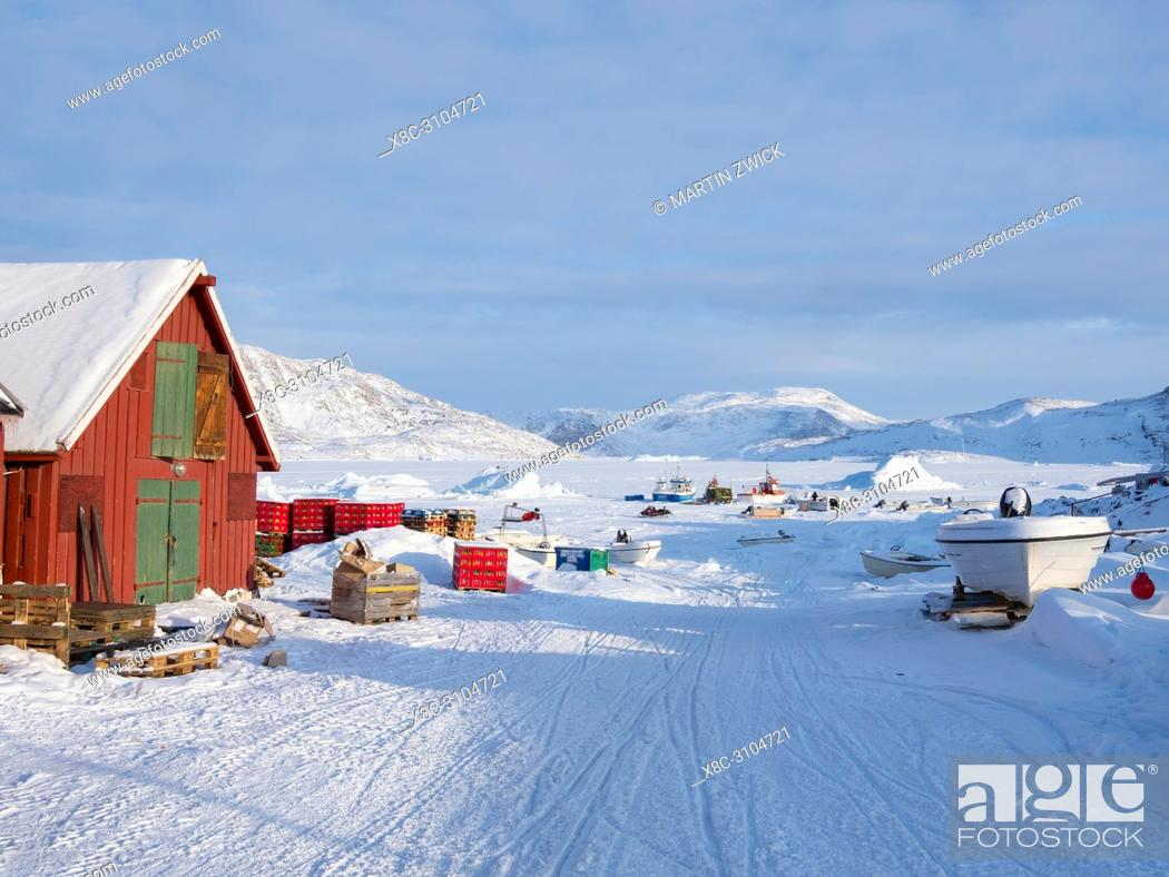 Stock Photo: The fishing village Ikerasak during winter in the Uummannaq fjordsystem north of the polar circle. America, North America, Greenland, Denmark.
