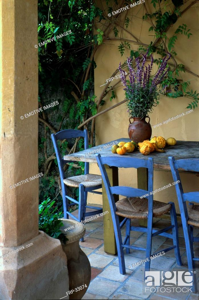 Stock Photo: Mediterranean seat with blue chairs.