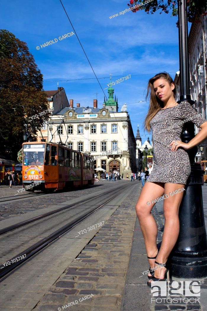 Imagen: Sexy and thin Ukrainian woman wearing a leopard-skin print dress posing near the tram rail for a photographic sequence in the ancient city of Lviv, Ukraine.