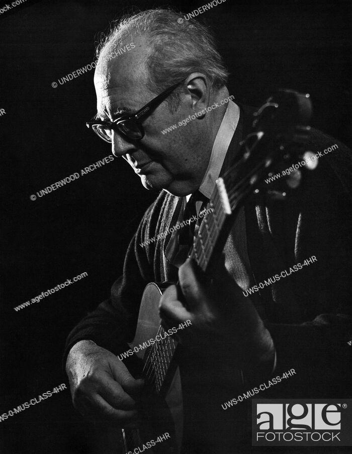 Stock Photo: Spain: c. 1950 A portrait of virtuoso classical guitarist Andres Segovia.
