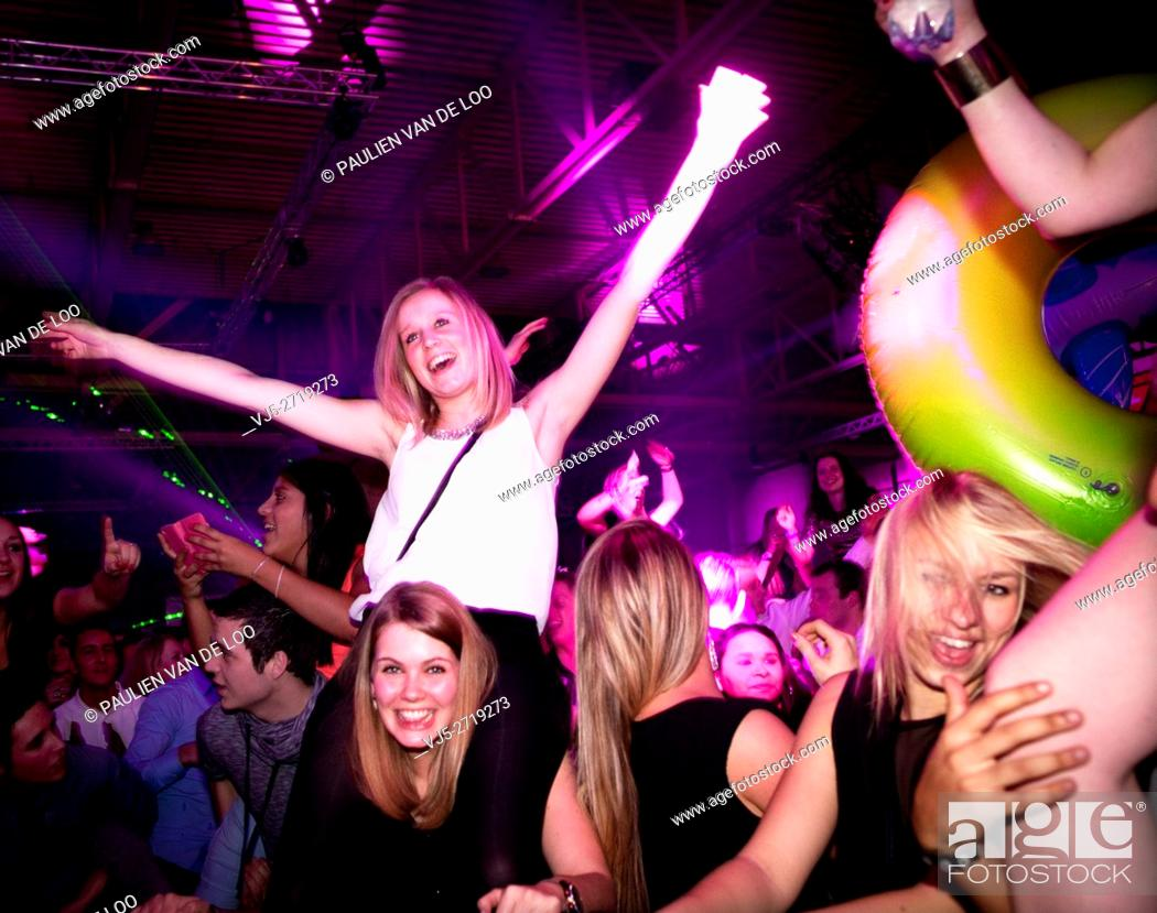 Stock Photo: 's Hertogenbosch, Netherlands, girls having fun on a night out.