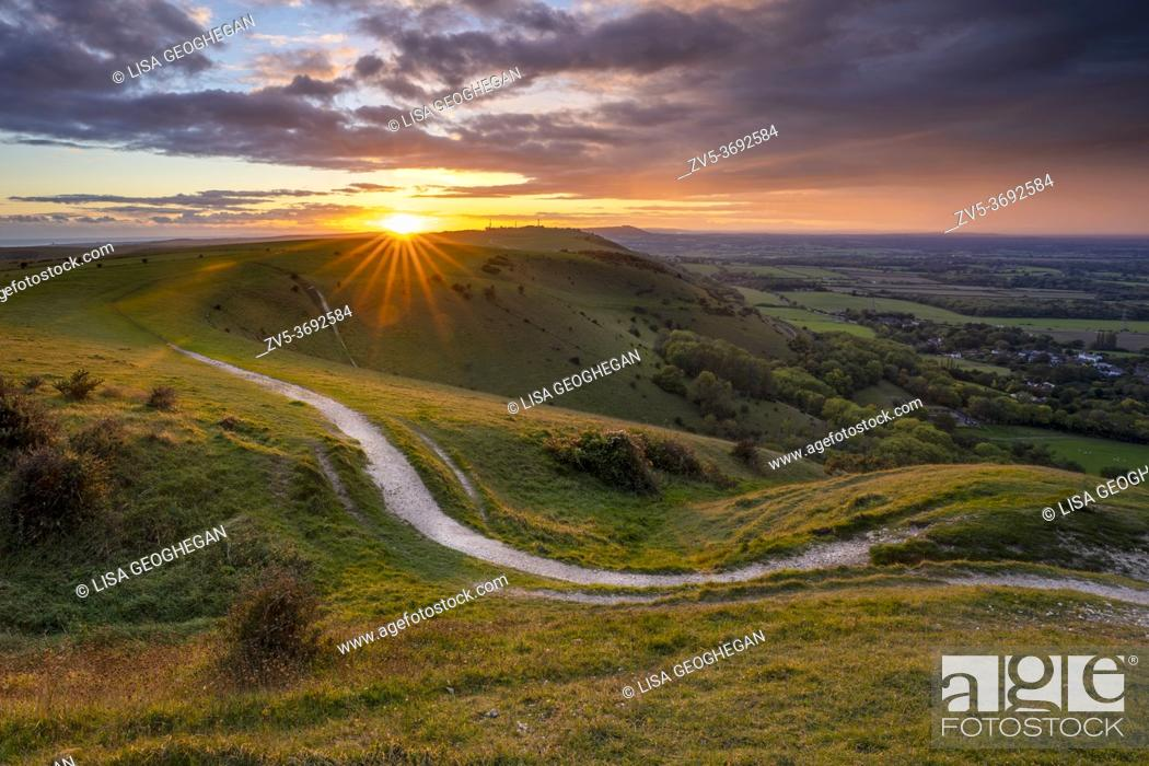Stock Photo: Sunset over Fulking village and views towards truleigh hiill and the sea on the South Downs National Park from Devil's Dyke, Sussex, England.