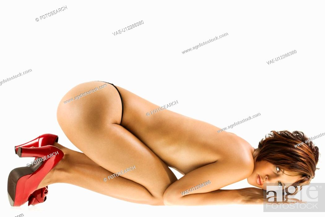 Stock Photo: Studio portrait of young partially nude Caucasian woman.