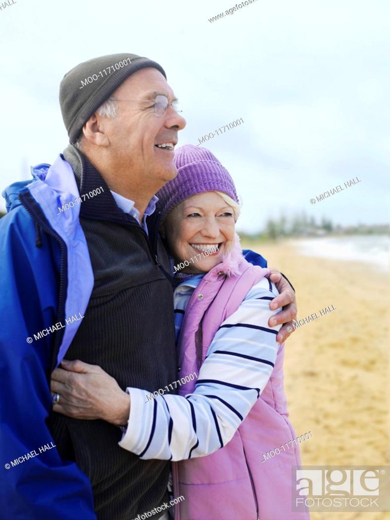 Stock Photo: Senior couple embracing outdoors.
