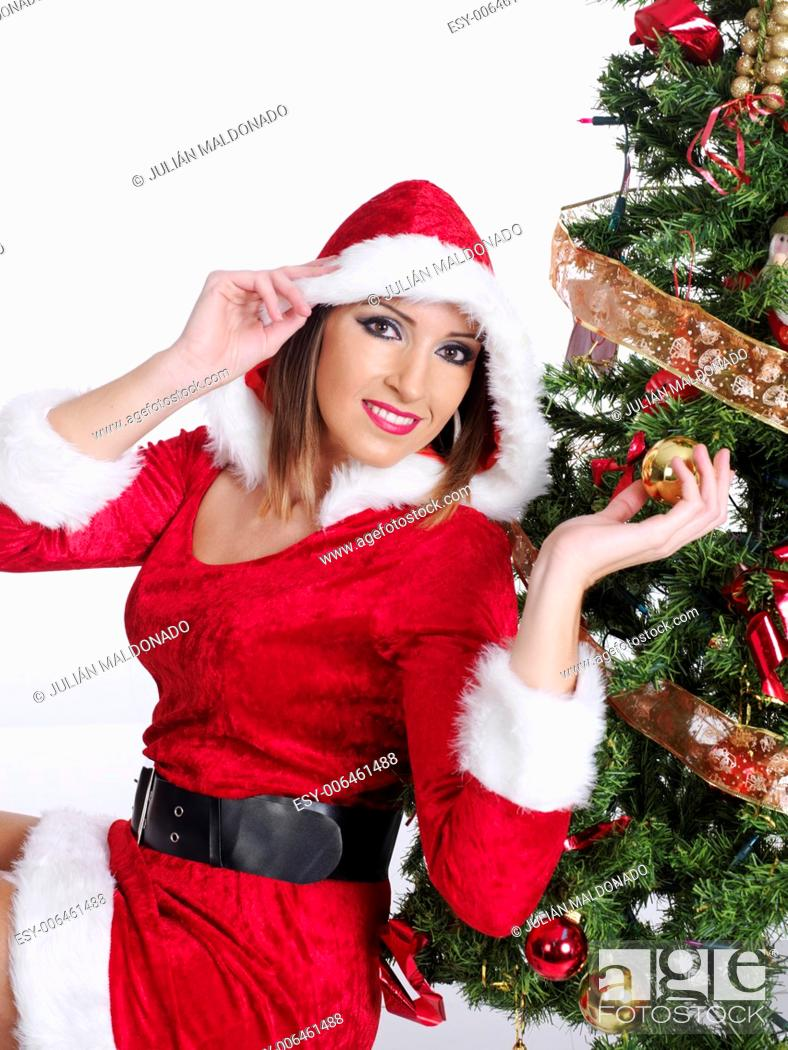Stock Photo: Young woman dressed in Mama Claus with some shopping and gifts.