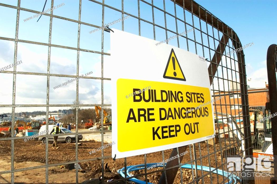 Stock Photo: Construction site with danger sign hanging on the access gate.