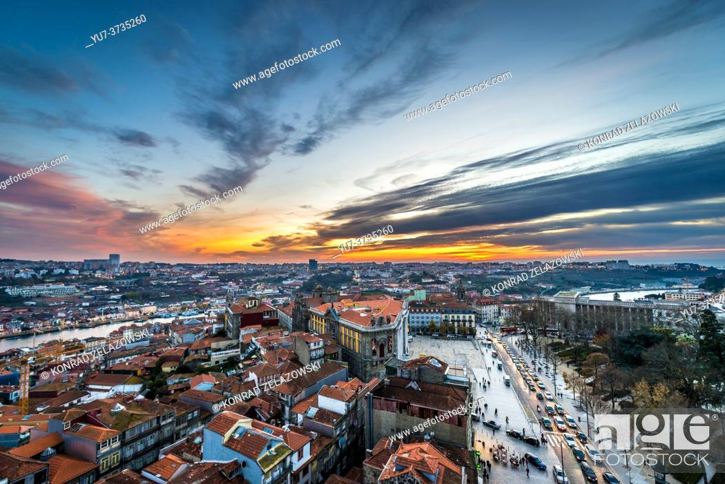 Stock Photo: Evening aerial view from bell tower of Clerigos Church in Porto, second largest city in Portugal. Vila Nova de Gaia city on background.