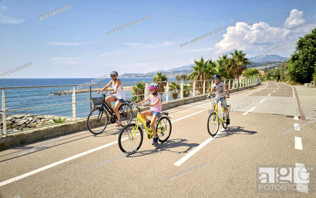 Stock Photo: Mother with children during bicycle tour between San Lorenzo and San Remo, Italy.