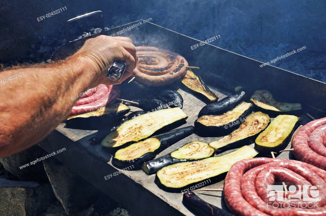 Stock Photo: Sausages and eggplants / avocado on a BBQ.