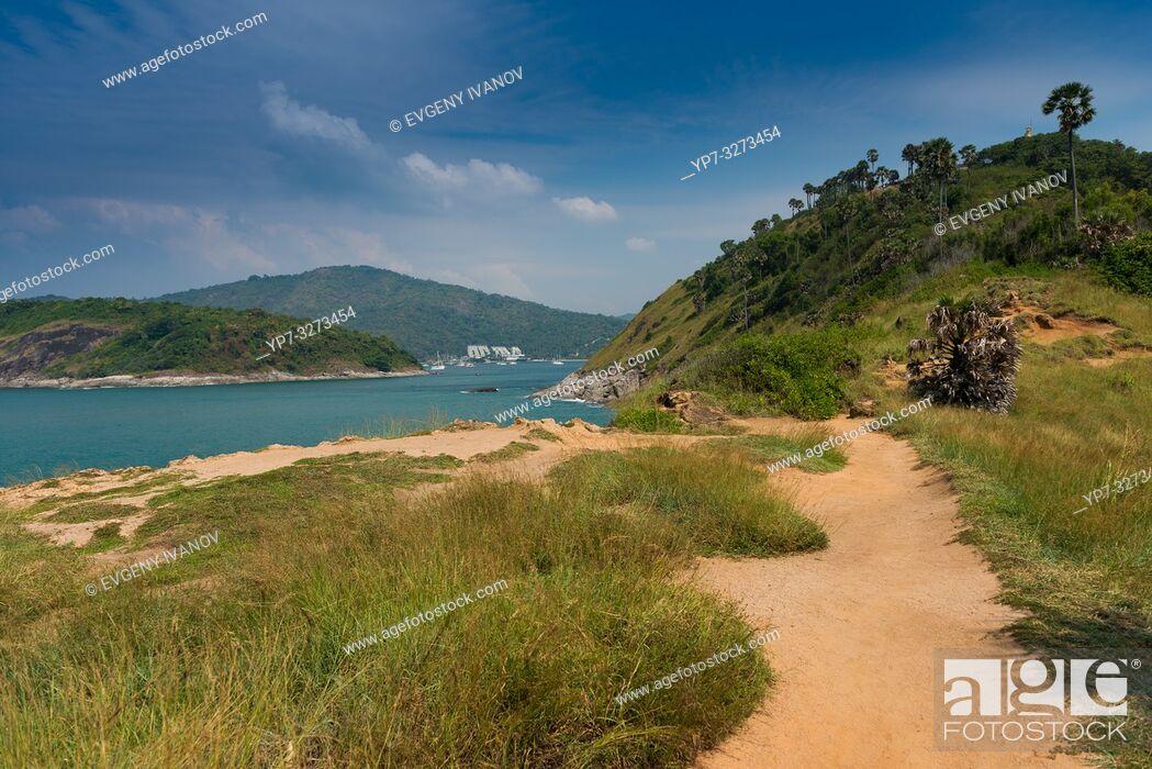 Stock Photo: Dirt road trail on Promthep cape, Phuket, Thailand.