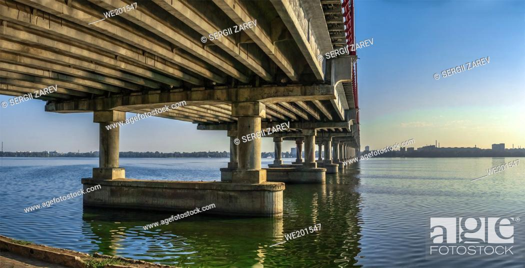 Stock Photo: Dnipro, Ukraine 07. 18. 2020. Central bridge in the city of Dnipro, Ukraine, on a sunny summer morning.