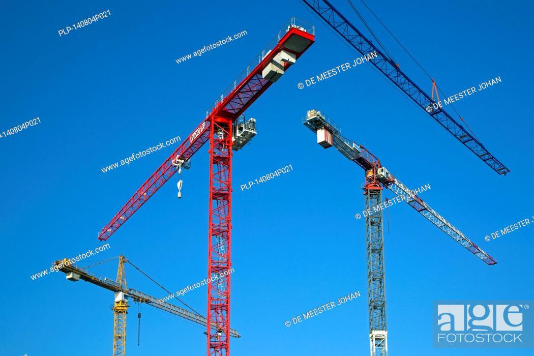 Stock Photo: Construction cranes / tower crane against blue sky.