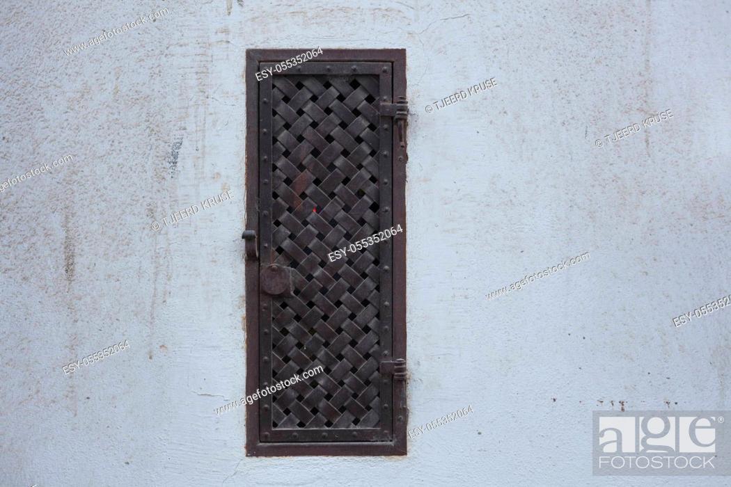 Stock Photo: Old metal ornamented window.