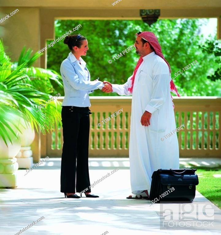 Stock Photo: Handshake between businesspeople.