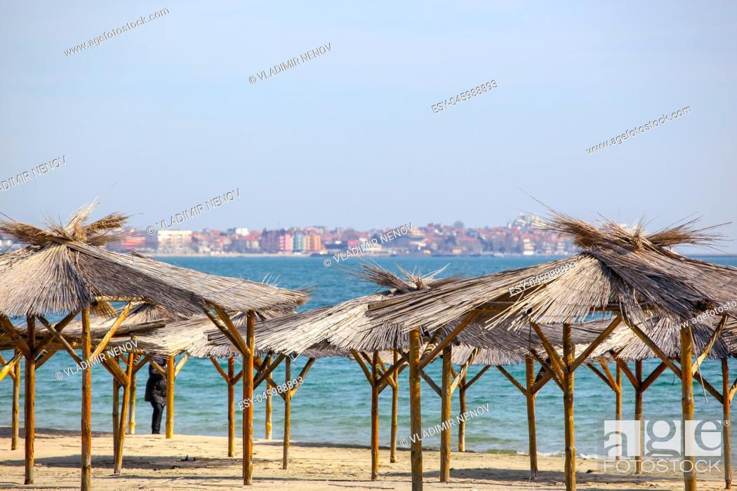 Stock Photo: Umbrellas In Sand On Empty Beach.