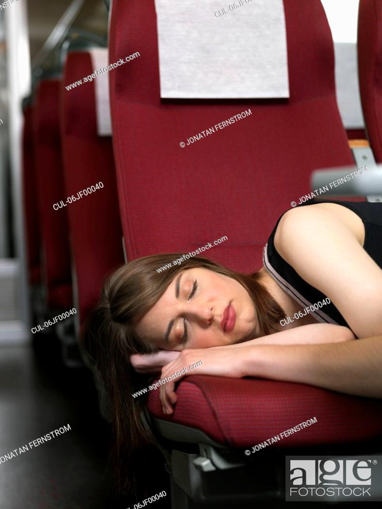 Stock Photo: Woman sleeping in train.