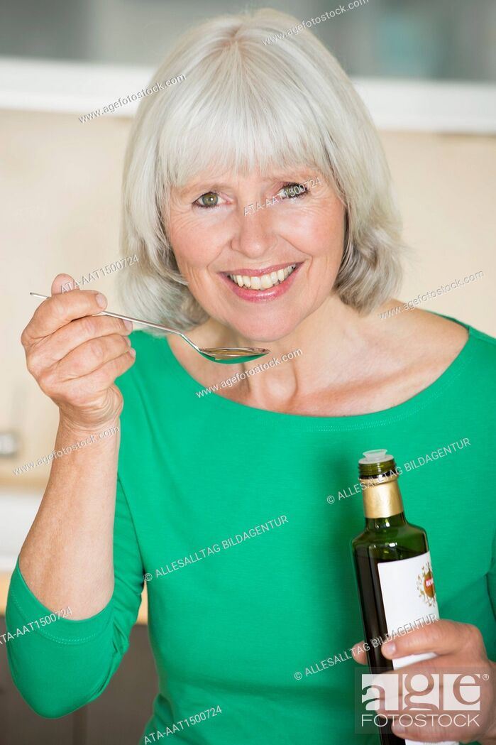 Stock Photo: Elderly with olive oil.
