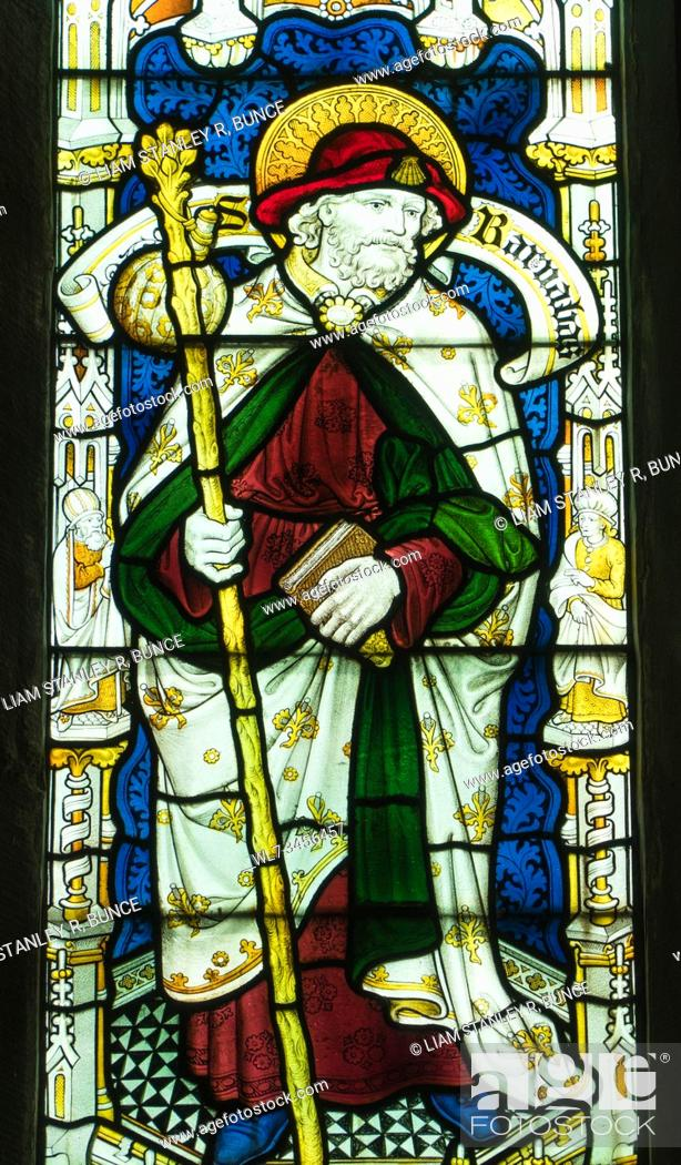 Stock Photo: Stained glass depicting St Barnabas, St Mary's Priory Church, Abergavenny Wales UK. May 2019.