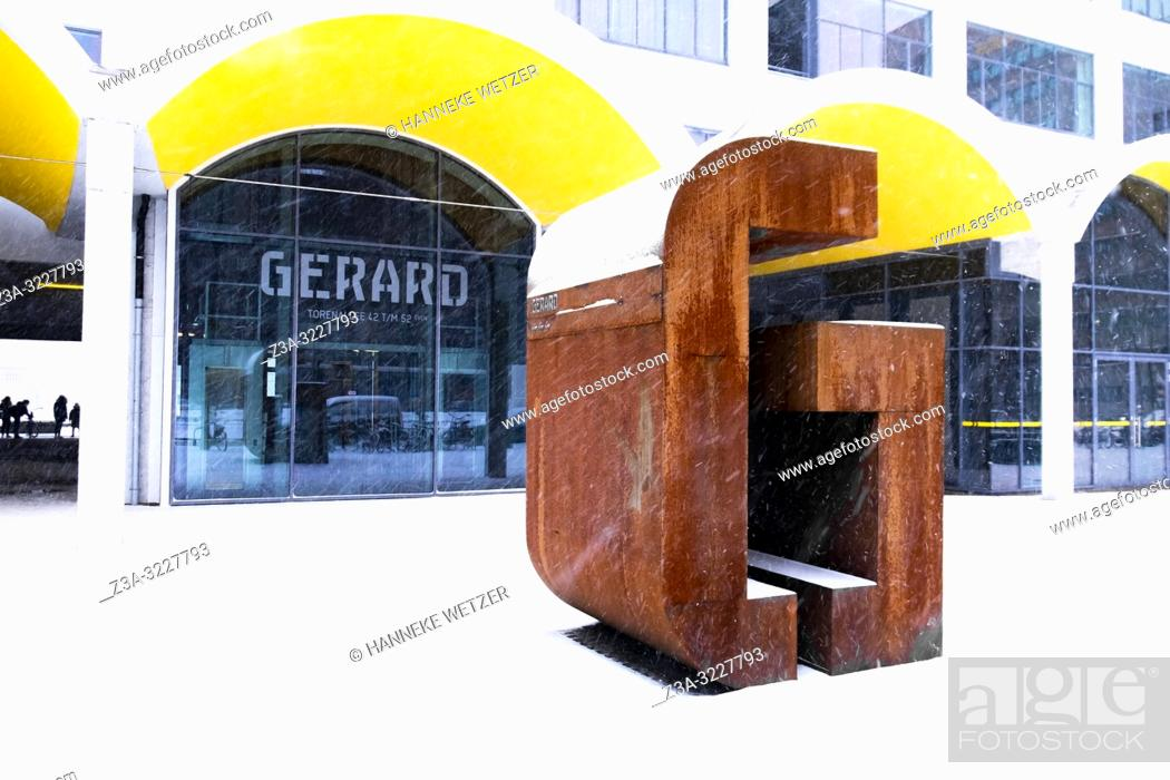 Big letter G in front of building Gerard at industrial