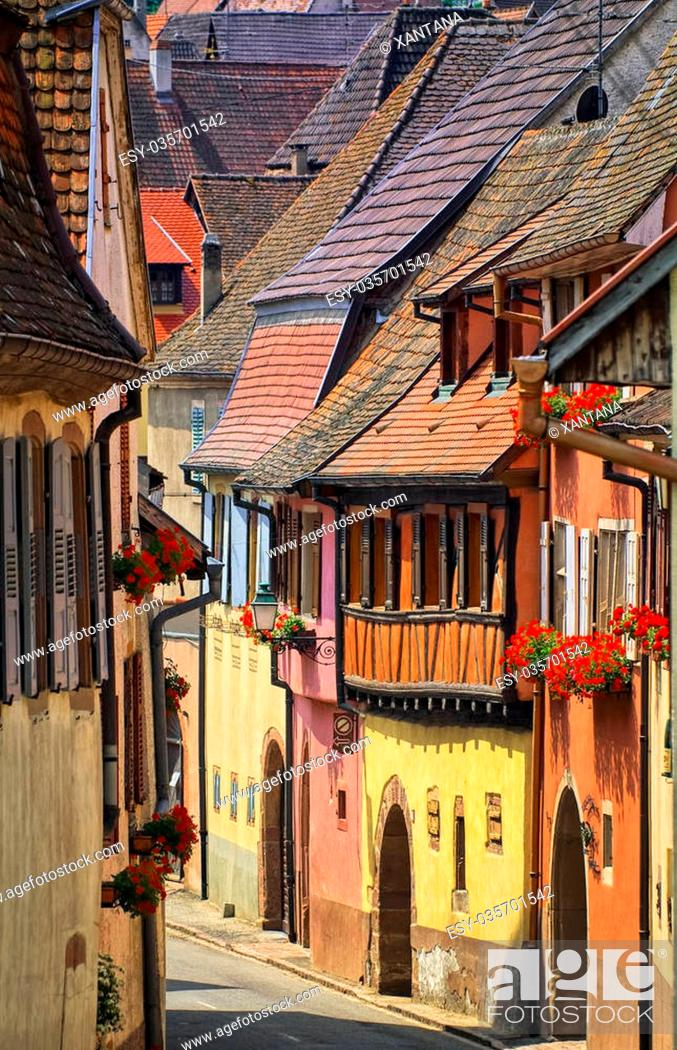 Stock Photo: Narrow colorful street in Kayserberg village by Colmar, Alsace, France.