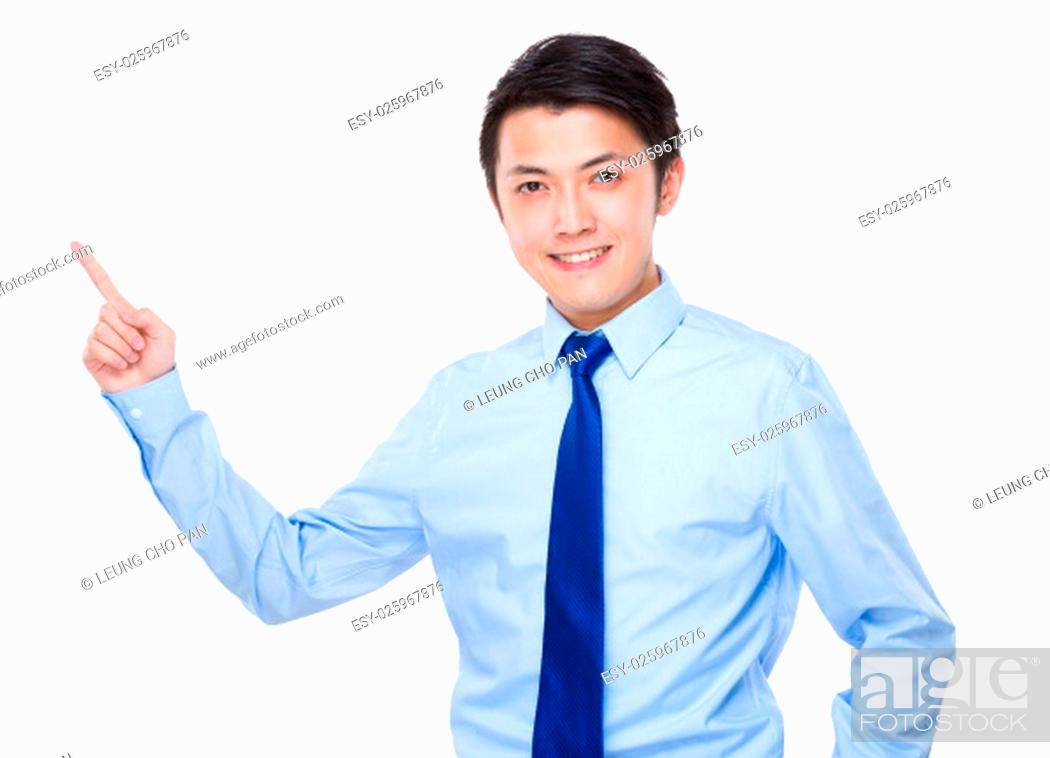 Photo de stock: Young businessman with finger point up.