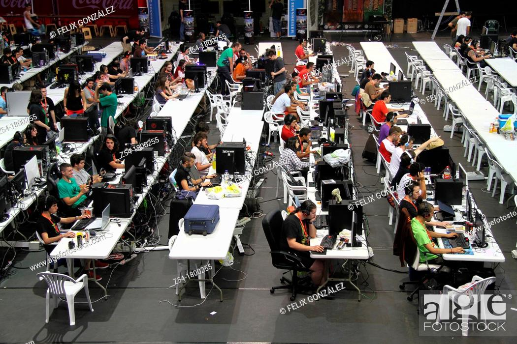 Imagen: Participants of a Aviles computer party , sitting in front of computers screens and playing computers games, Asturias, Spain.