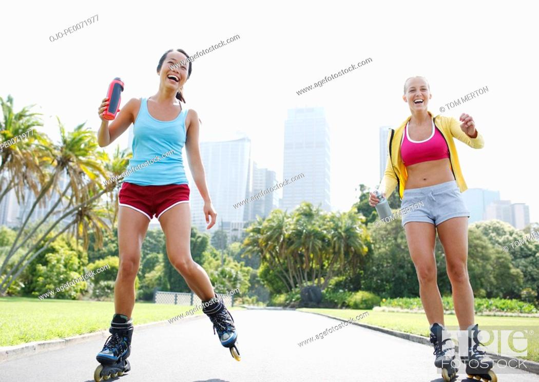 Stock Photo: Friends rollerblading in park.