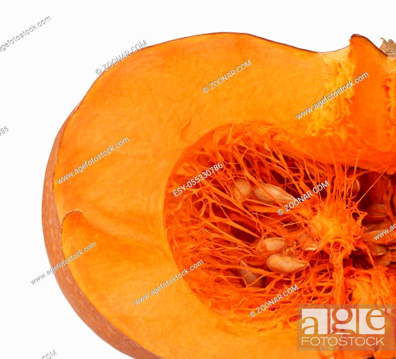 Stock Photo: halved big orange pumpkin with seeds isolated on a white background, autumn harvest.